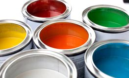 Multicolored Paint Cans on background. Color red paint cans home improvement paint brush cans of paint stock photo