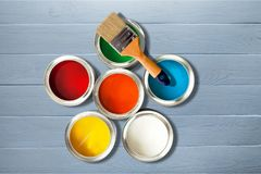 Multicolored Paint Cans and Paint brush. Home improvement paint brush cans of paint green color red yellow stock photos