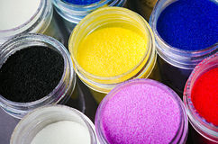 Multicolored paint in jars. A lot of multicolored paint in jars for makeup artistry Royalty Free Stock Photo