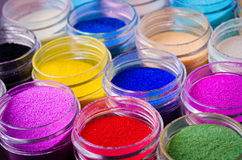 Multicolored paint in jars. A lot of multicolored paint in jars for makeup artistry Stock Image