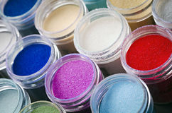 Multicolored paint in jars. A lot of multicolored paint in jars for makeup artistry Stock Photos
