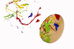 Multicolored paint sprays on the egg Royalty Free Stock Photo