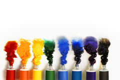 Multicolored paint tubes on a white background Stock Images
