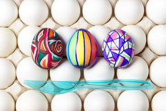 Multicolored painted easter eggs on white tray, food photography Royalty Free Stock Images