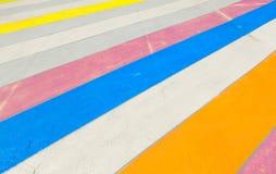 Multicolored painted sidewalk. Stock Photo