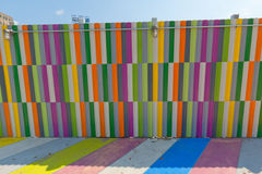 Multicolored painted sidewalk and walls. Royalty Free Stock Image