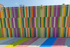 Multicolored painted sidewalk and walls. Royalty Free Stock Photos