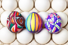 Multicolored painted tree easter eggs on white tray, food photography Stock Photos