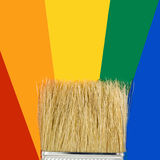 Multicolored paints and brush Stock Photo