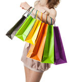 Multicolored paper bags on female hand Stock Images