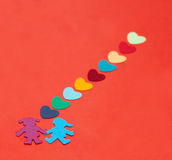Multicolored paper boy and girl with multicolored paper hearths Royalty Free Stock Images