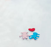 Multicolored paper boy and girl with red paper hearth Royalty Free Stock Images
