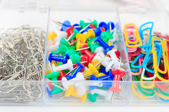 Multicolored paper clips and buttons stationery Stock Images