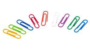 Multicolored paper clips isolated on white Royalty Free Stock Photos