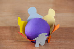 Multicolored paper cut outs forming a circle with a ball in between Stock Images