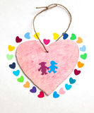 Multicolored paper hearths with  a wooden pink heart and paper boy and girl Royalty Free Stock Photography