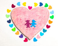 Multicolored paper hearths with  a wooden pink heart and paper boy and girl Stock Image