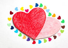 Multicolored paper hearths with a wooden red and pink hearts Royalty Free Stock Photos