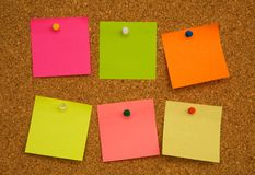 Multicolored paper notes on cork board royalty free stock photo
