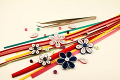 Multicolored paper and paper flowers Royalty Free Stock Photo