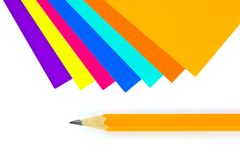 Multicolored paper and pencil Royalty Free Stock Photos