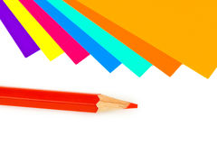 Multicolored paper and pencil Royalty Free Stock Images