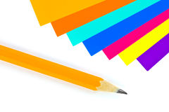 Multicolored paper and pencil Stock Images