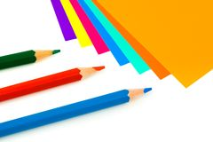 Multicolored paper and pencils Royalty Free Stock Photos