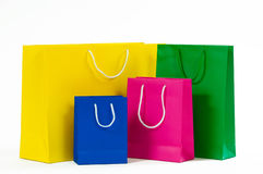 Multicolored paper shopping bag isolated on white.  Stock Photos
