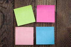 Multicolored paper stickers note on wooden Royalty Free Stock Photography