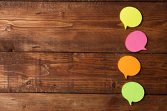 Multicolored paper stickers on wooden table Royalty Free Stock Photography