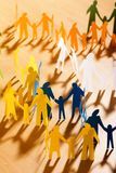 Multicolored papery people stock photo