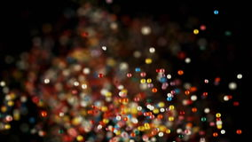 Multicolored particles flying after being exploded, colorful sprinkles flying and falling down. Multicolored particles flying after being exploded, colorful stock video
