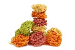 Multicolored pasta stock images