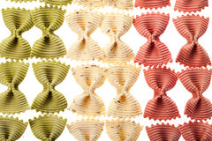 Multicolored pasta background as Italy flag Stock Images