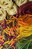 Multicolored pasta close-up. Pasta of different shapes. royalty free stock images