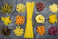 Multicolored pasta close-up. Pasta of different shapes stock photos