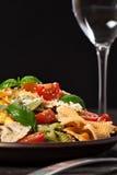 Multicolored pasta on dark background Stock Photo