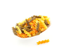 Multicolored pasta on a white background Stock Photos