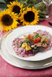 Multicolored Pasta vertical. Salad of Multicolored Pasta with raw vegetables stock image