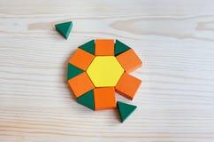 Multicolored patroonblokken op een lichte houten achtergrond Stock Foto