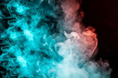 Multicolored pattern of the smoke of the green and red colors of royalty free stock photo