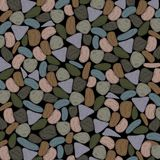 Multicolored Pebbles Background in Dull Grenish Grey Tones. This Multicolored Pebbles background is a beautiful blend of chocolate and walnut brown undertone Stock Photos