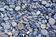Multicolored pebbles and stones. Aerial view of multicolored and various sized rounded rocks and stones Stock Photo