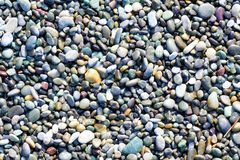 Multicolored pebbles and stones. Aerial view of multicolored and various sized rounded rocks and stones Royalty Free Stock Photography
