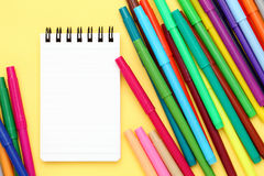 Multicolored pen and notebook Stock Photos
