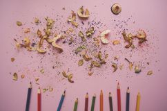 Pencils and shavings on pink background. royalty free stock photo
