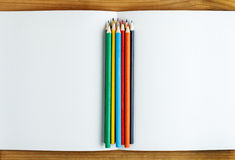 Multicolored pencils with album Stock Image