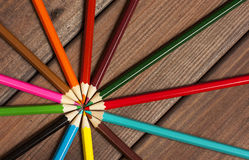 Multicolored pencils on a background of dark wood tables Royalty Free Stock Photography