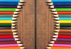 Multicolored pencils on a background of dark wood tables Stock Photo